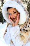 Portrait of young woman in fur coat Royalty Free Stock Image