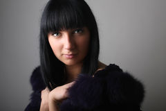 Portrait of young woman in fur coat Stock Photo