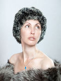 Portrait of the young woman in a fur coat Royalty Free Stock Images