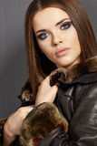 Portrait of young woman . Fur, leathe Royalty Free Stock Images