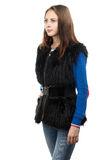 Portrait of the young woman in fur waistcoat Royalty Free Stock Images