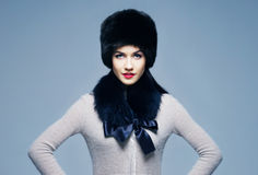 Portrait of a young woman in a furry winter hat Stock Images