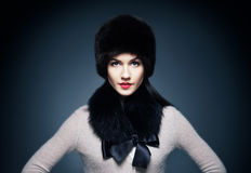 Portrait of a young woman in a furry winter hat Royalty Free Stock Photos