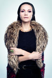 Portrait of a young woman in furs. And jewels Stock Images