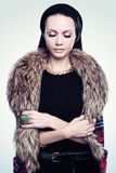 Portrait of a young woman in furs. And jewels Stock Image