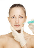 Portrait of young woman getting cosmetic injection Royalty Free Stock Photography