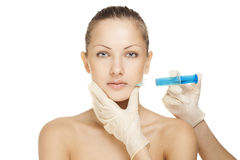Portrait of young woman getting cosmetic injection Royalty Free Stock Photos