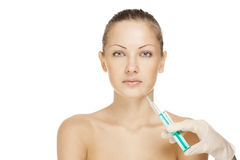 Portrait of young woman getting cosmetic injection Royalty Free Stock Photo