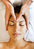 Portrait of a young woman getting spa treatment. Face massage Royalty Free Stock Photography