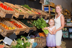 Portrait of young woman and girl buying greens Stock Photography