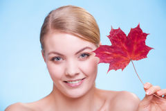 Portrait of young woman girl with red maple leaf. Royalty Free Stock Photos