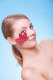 Portrait of young woman girl with red maple leaf. Stock Photos