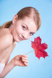 Portrait of young woman girl with red maple leaf. Stock Photography