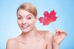 Portrait of young woman girl with red maple leaf. Stock Images
