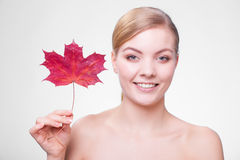 Portrait of young woman girl with red maple leaf. Royalty Free Stock Images
