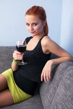 Portrait of young woman with glass red wine Stock Photography