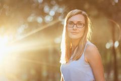Portrait of young woman with glasses in backlight Stock Photography