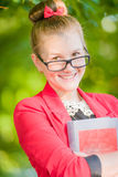 Portrait of a young woman in glasses with book Royalty Free Stock Photo