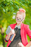 Portrait of a young woman in glasses with book Royalty Free Stock Image