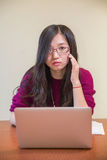 Portrait of young woman. With glasses, book and laptop Stock Images