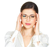 Portrait of an young woman in glasses with headache Stock Photo
