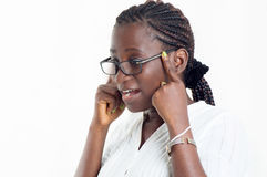 Portrait of young woman with glasses on white background. This young woman appreciates his vision with these new glasses Stock Photo