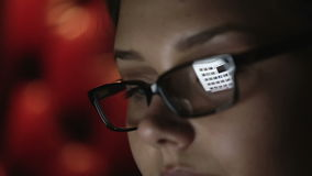 Portrait of a young woman with glasses who works at night. Close up profile face stock video