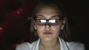Portrait of a young woman with glasses who works at night. Close up profile face stock video footage