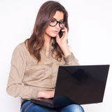 Portrait of young woman with glasses and mobile  p Royalty Free Stock Photography