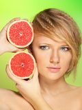 Portrait of  young woman with grapefruit Stock Image
