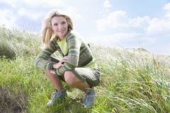 Portrait of young woman in grass royalty free stock image