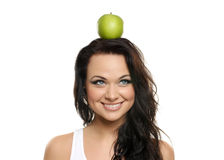 Portrait of a young woman with a green apple Royalty Free Stock Photos