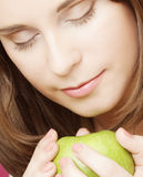Portrait of young woman with green apple Royalty Free Stock Photos