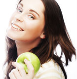 Portrait of young woman with green apple Royalty Free Stock Photo