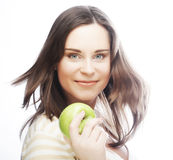 Portrait of young woman with green apple Stock Images