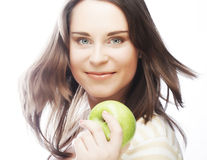 Portrait of young woman with green apple Stock Image