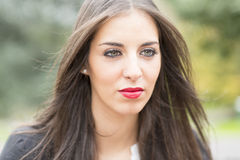 Portrait of young woman with green eyes and makeup. Stock Photos