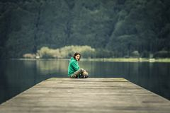 Portrait of young woman in green sweatshirt. royalty free stock photos