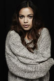 Portrait of young woman in grey sweater. Young woman in grey sweater hugging self Stock Photography