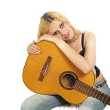 Portrait of young woman with guitar Royalty Free Stock Photography