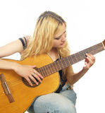 Portrait of young woman with guitar Stock Images
