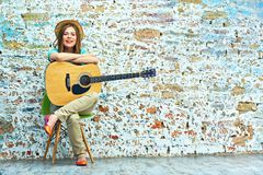 Portrait of young woman with guitar. Royalty Free Stock Images