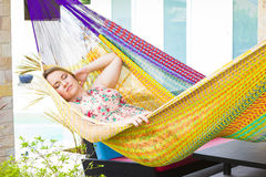 Portrait of young woman in hammock at summer day Stock Photography