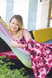 Portrait of young woman in hammock at summer day Stock Images