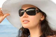 Portrait of the young woman in a hat Stock Photos
