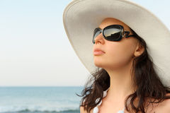 Portrait of the young woman in a hat Royalty Free Stock Images