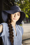 Portrait of young woman in hat. Portrait of attractive young girl in hat in the park Royalty Free Stock Photos