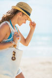 Portrait of young woman in hat and with bag on beach Stock Photography