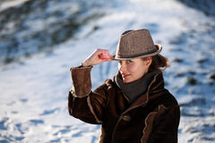 Portrait of a young woman with hat. Beautiful young woman in a park in winter time stock photos