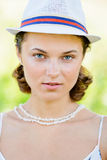 Portrait of Young Woman with a Hat Outdoor Stock Image